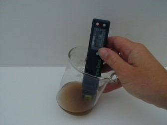 Hand using the right pH testing method